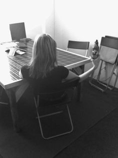 Green #draping in the Global Green office: sitting at a table made from a recycled solar panel and holding an eco-friendly reusable water bottle.