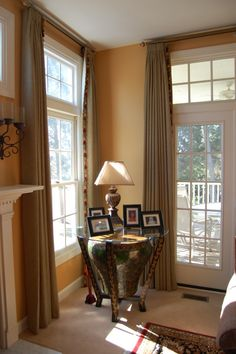 I like how the curtains are hanging and the windows. Beachnut Lane: Soft yellows from Benjamin Moore~ Hawthorne Yellow, Weston Flax, Concord Ivory! Gold Paint Colors, Wall Colors, House Colors, Hawthorne Yellow, Paint Walls, Yellow Interior, Living Room Kitchen, Dining Room, Benjamin Moore