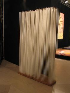 Room divider from fiber glass bars A thick wood from fever glass sticks brings the visitor to the reflection whether this is a simple room divider or modern art. Free Standing Wall, Space Dividers, Wall Dividers, Diy Room Divider, Divider Ideas, Partition Design, Partition Walls, Glass Partition, Cool Rooms