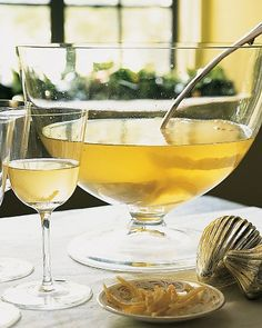 Lemon-Drop Champagne Punch  Simple syrup infused with lemon zest adds aromatic sweetness to this punch made of vodka, lemon juice, and a bottle of Champagne. Garnish each glass of sparkling punch with a strip of candied lemon peel.