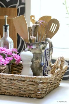 Hi Sugarplum | Use unexpected items to organize your kitchen...like a vintage silver pitcher for utensils and baskets to corral oils