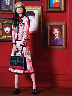 A model in the installation by the artist Unskilled Worker (Helen Downie), with portraits depicting looks from Gucci's fall 2015 men's and women's collections. Model wears Gucci.