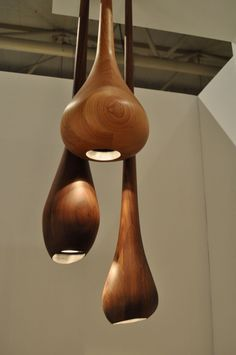 Beautifully turned wood pendant lamps by Carroll Street Woodworkers of Toronto. Smooth, wooden, organic design, reminiscent of drops of water. Interesting how it makes you think of wood but also water at the same time