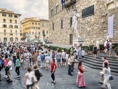Tourists around the replica of Michelangelo's David in the Piazza della Signoria, Florence.. Where to Go in 2018 - Bloomberg