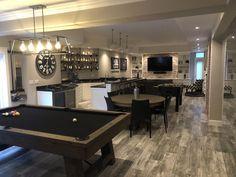 Basement bar, basement pool table, black and white basement, basement game room #inexpensivewaystodecorateanunfinishedbasement