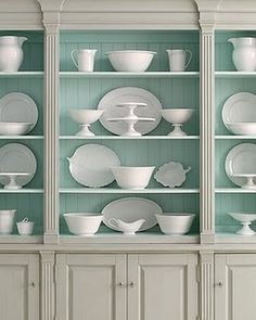 Lovely china hutch.  Painting the inside a soft pastel hue is a fabulous idea.