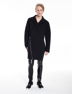 Model is wearing: black Origami coat made of neoprene and Universum pants made of black eco-leather with WAX effect