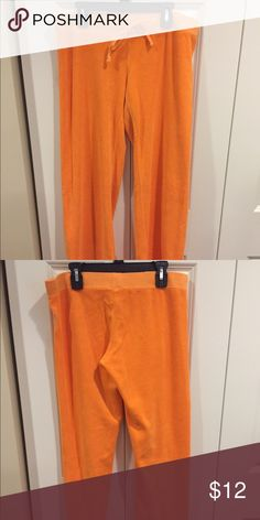Juicy Couture Terry Pants These pants are like new. There are no signs of wear on them. They are a bright summer orange. The comfy level of these pants is very high. Juicy Couture Pants Track Pants & Joggers
