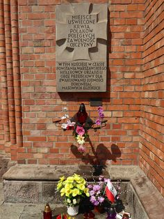 """A """"Tchorek plaque"""" near the entrance of Kościół Świętego Wojciecha (Saint Wojciech's Church) in the Wola district of Warsaw. The plaque commemorates the fact that the Germans used this church as an execution site during the Wola massacre, and subsequently as a detention centre prior to expelling the survivors from Warsaw...."""