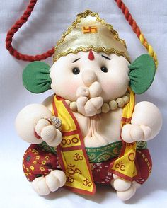 Baby Ganesha (Cloth)) Lord Ganesha is a popular Hindu deity. He is the son of Lord Shiva and Goddess Parvati, has the head of an elephant, and is also popularly known as the Hindu elephant god. He is also said to be a master of the music and dance. This cute doll depicts Ganesha as a baby.