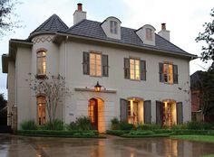slate roof. stucco. weathered shutters. clean landscaping. great lighting.