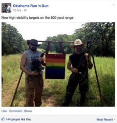 Awesome, two gay gun enthusiasts pose with a rainbow poster to express their love for one another!