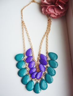 Two layers of golden chain with purple and blue drops
