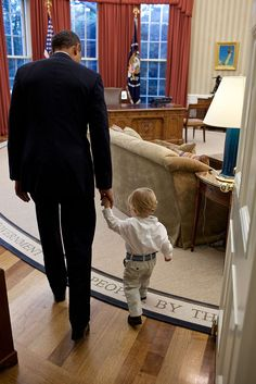 """Sept. 29, 2011 """"When a White House staff member leaves their job, the President usually invites the staff member and his family to the Oval Office for a family photo to thank them for their service. Here the President walks with William Jones, son of departing aide Luke Jones, before a family photo.""""  (Official White House Photo by Pete Souza)"""