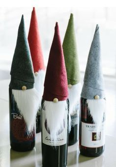 64 Homemade Christmas Gift Ideas DIY Wine Elf - To dress up a bottle of wine as a holiday hostess gift, cut felt into an rectangle and faux fur into a triangle roughly 2 inches wide by 4 inches long. Wrap felt rectangle into a cone shape, securing the Homemade Christmas Gifts, Homemade Gifts, Christmas Holidays, Christmas Wine, Christmas Gnome, Christmas Crafts For Gifts For Adults, Crafty Christmas Gifts, Funny Christmas, Christmas Ideas