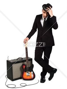 businessman with guitar and amplifier. - Young businessman with guitar and amplifier over white background, Model: Kareem Duhaney