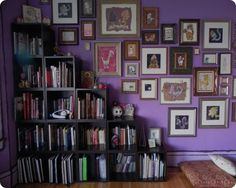 I like the design of the gallery and bookcase --- add in a bigger pillow and lighten up the wall coloring and it would be purrrrfect for me.