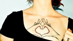 Hands in the shape of a Claddagh tattoo.