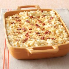 Macaroni is baked with smoked Gouda, Swiss, white cheddar, goat cheese and Parmesan and topped with crispy prosciutto