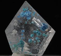 Quartz, Gilalite Locality: São José da Batalha, Salgadinho, Borborema mineral province, Paraíba, Brazil Dimensions: 1.8 x 1.6 x 0.9cm.  Optically pure Quartz with vivid blue/green Gilalite inclusions. Gilalite inclusion in Quartz was discovered in 2005 in a mere 10 kilos of Brazilian Quartz crystals.  Reference: GIAs Gems & Gemology Magazine Fall 2005 article, volume 41, issue 3.