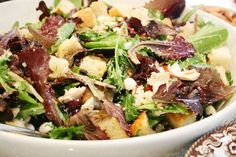 Tuscan Bread Salad - In a large serving bowl, put the grilled bread (cubed) in with the olives, tomatoes, mozzarella, parmesan, pine nuts, chicken, basil and greens. Pour vinaigrette over the salad and mix well.