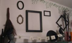 Frames painted black, with strung parchment paper spelling out 'wicked'.  Black crow candle holders, small broom, vases and black tingting