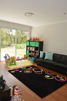 Nicole from the Brisbane area shares photos of her brand new Mornington acreage home (now called the Bronte). This is the space designed for the kids - the Children's Activity Room. Discover Nicole's story at http://mcdonaldjoneshomes.com.au/about/latest-news/news/tranquil-qld-bushland-inspired-couples-journey.  #children #kids #activityroom #fun #toys #newhome