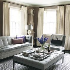 Monochromatic hues and highly hung curtain rods add a sense of space and flow to small, low-ceilinged rooms.