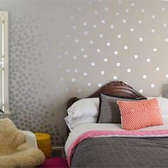 Add fun to boring colored walls with metallic polka dots created with a shoe polish sponge!