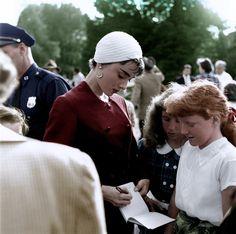 Audrey Hepburn signs autographs for fans on the set of Sabrina (1954)