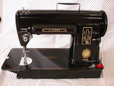 It was dangerously easy to acquire 3 different sewing machines. This is my favourite, my 301 scored for $10 at a yard sale. But I don't have the heart to pull the old 411 out of it's cabinet to install my beauty.