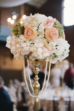 Nothing goes better with elegant florals than strings of pearl! View the full wedding here: http://thedailywedding.com/2016/01/21/fantastic-rainy-wedding-mandy-ryan/