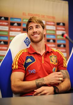 Sergio Ramos Photos Photos - Sergio Ramos of Spain smiles as he talks to the media during a press conference ahead of the UEFA EURO 2012 final match against Italy on June 29, 2012 in Kiev, Ukraine. - Spain Press Conference - UEFA EURO Final 2012
