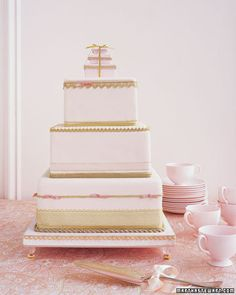 Three pink tiers are embellished with a sparkling array of gold trims and ribbons