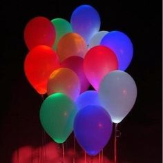 Glow sticks inside helium balloons!  Awesome idea for night time entertaining. Saw this on HomeMint.com