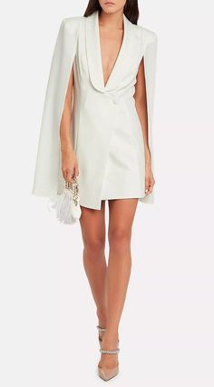Bridal mini dresses are a statement-making trend that's here to stay. So we've researched the best short wedding dresses for the modern bride. Katie May Cape White Dress