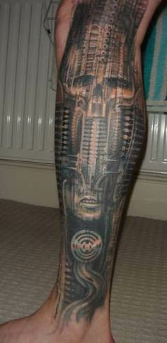 biomechanical-skull-leg-tattoo