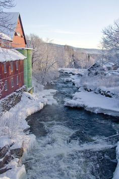 Winter scene with river & red barn