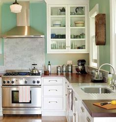 like #farmhouse style pendants, pluse range and hood, drawer pulls, butcher block counter top -- ok, pretty much everything