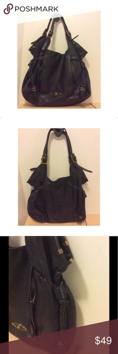 Elliott Lucca Black Leather Hobo Handbag Gently loved with normal signs of wear marks on handle areas see photos. Interior in good condition all zipper work.  ELLIOTT LUCCA SINTRA VERY LARGE PEBBLED LEATHER HANDBAG  This bag has everything, plenty of room with 2 open pockets and a zipper pocket inside. The best though are the hidden outside zipper pockets on each side. The leather is super soft pebbled leather, interior is pretty blue floral fabric, and the closure is magnetic Please view…