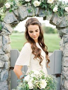 What a gorgeous wedding hairstyle!! Click here for more simple and elegant outdoor wedding reception ideas. #weddinghairstylesforlonghair #elegantbrides #weddingreceptionideas