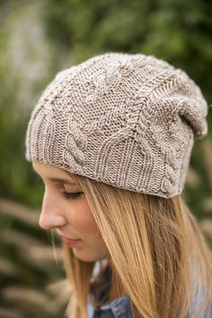"""Are you looking for a hat with just a little bit of slouch, intriguing ribbing, entertaining cables and all that jazz? Look no farther - """"All that Jazz"""" has everything one would want in the perfect hat. It is seamless, knit from the bottom-up, fully charted while at the same time fully written out … and all that jazz."""