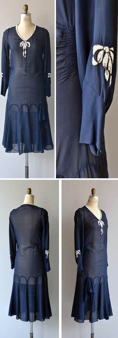 Day dress ca. 1920s. Navy blue sheer silk chiffon with white bow collar composed solely of tiny opaque beads. Ruched sides at waist, repeated beaded bows on each sleeve and panel-constructed skirt. No closures, fits over the head and would be worn with a slip. Dear Golden/etsy