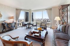 25 Columbus Circle, Apt. 53B: Spectacular Central Park views from this superb home, located in the South Tower on the 53rd floor of the Time Warner Center - one of New York's most prestigious buildings. This gracious two bedroom, two and half bathroom apartment boasts 10' ceilings, rich herringbone wood floors and unobstructed views from floor to ceiling windows. The separate modern eat-in kitchen features marble counter tops and frosted glass cabinets.