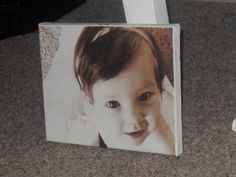 DIY canvas photo. Print on tissue paper then Modge Podge onto canvas. Big family photo in the front room?