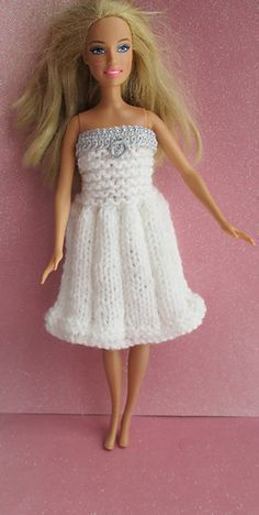 East knit dress for your Barbie doll using left over double knit yarn.