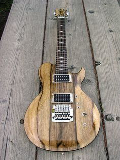 Neal Moser Magnum CT Custom Electric Guitar. Love that wood man! As you can probably tell by now on this board, I be LOVIN' me some funky woodwork on my pretties.