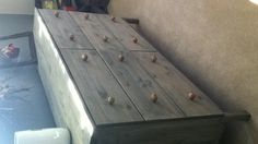 Ikea Tarva untreated chest $149, stained gray $7, new knobs from home goods $25