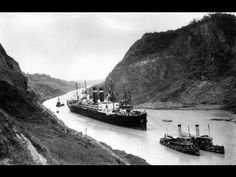 """"""" SS Kroonland is seen on 2 February 1915 at the Culebra Cut while transiting the Panama Canal. Kroonland was the largest passenger ship to that time to transit the canal.""""Kroonland in Panama Canal, 1915 Barbados, Jamaica, Jules Verne, Honduras, Panama History, Trinidad, Merchant Marine, Panama Canal, Bahamas"""