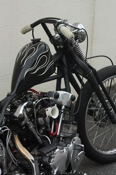 Knucklehead with chrome springer frontend, peanut tank, with fishtail pipes on one side. The one that got sold. :-(